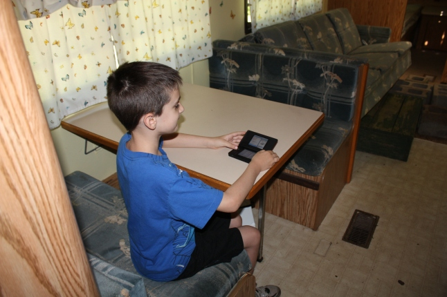 GS1 testing his DS playing capabilities at the dining room table.